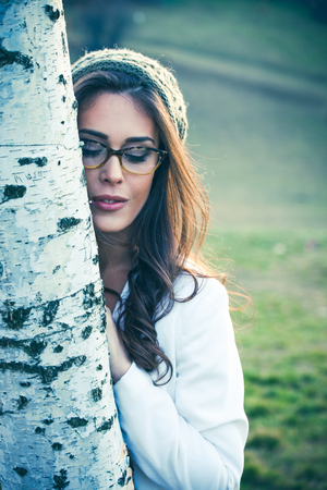 woman portrait: smiling beautiful young woman with eyeglasses outdoor portrait Stock Photo