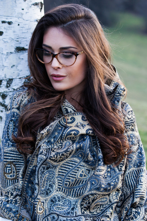 lean: beautiful girl portrait with eyeglasses and scarf outdoor closeup