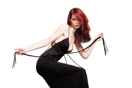 attractive red hair girl in long elegant black evening dress studio shot
