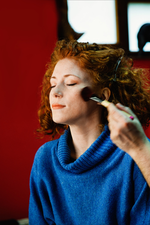 exceptionally: smiling ginger girl makeup portrait indoor Stock Photo