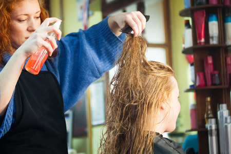 young woman in her hair studio apply hair  product to female customer small business concept