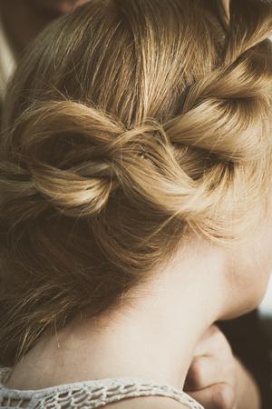 modern loose  braided woman hair closeup Stock Photo