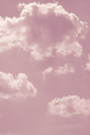 pink skies: fantasy pastel pink sky with white fluffy  clouds