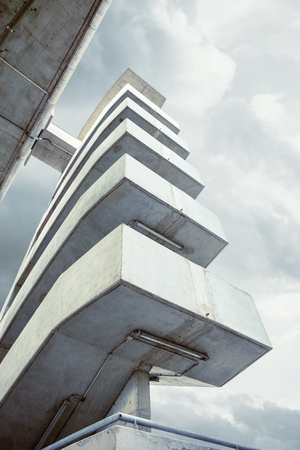 cloude: modern architecture outdoor stairs under  bridge shot from below Stock Photo