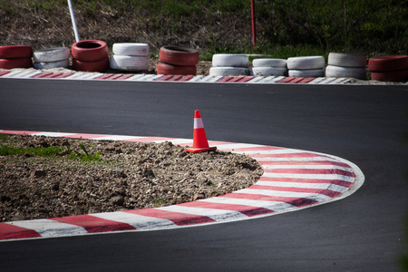 corner of the gokart track with curb and cone on new asphalt surface