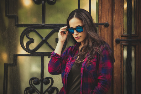 urban girl portrait with sunglasses in the city day shot photo