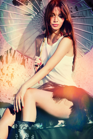 attractive beautiful young redhead woman with parasol outdoor hot summer day photo