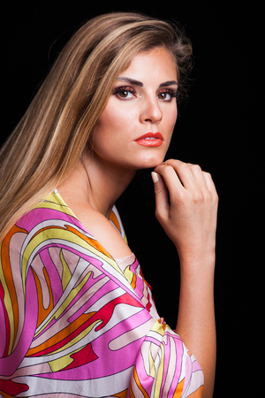 beauty young blonde woman portrait in colorful silky dress with interesting  makeup  crystals