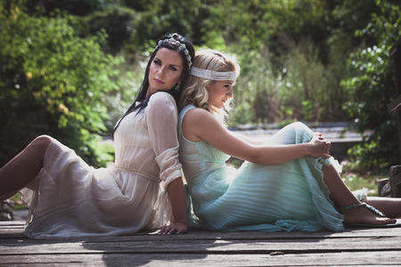 couple of women in romantic style  dresses outdoor shot summer day