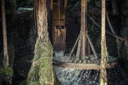 closeup of working traditional water mill wheel in mountain village