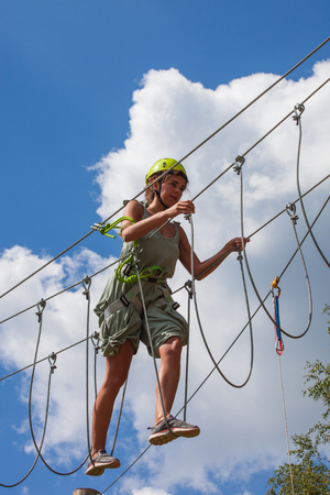 young woman in adventure park challenge concept