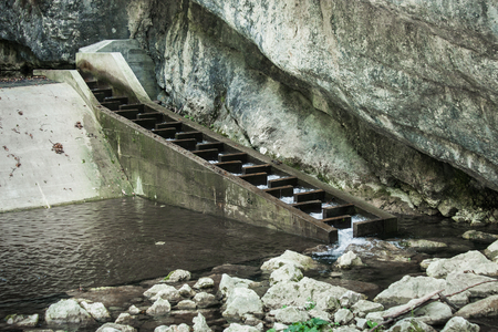 part of small hydropower station on mountain river closeup