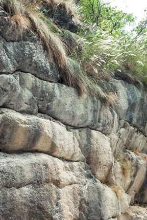 closeup of layers of rocks in a small mountain canyon