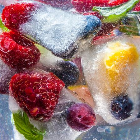 frozen  berries in water closeup background natural light