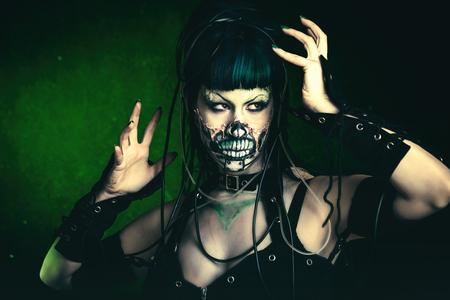 Scary cyber skeleton woman portrait studio shot