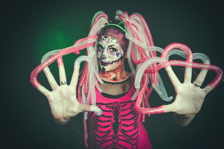 halloween woman with sugar skull makeup studio shot