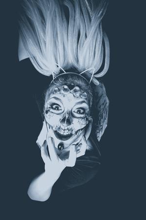 scary halloween woman with sugar skull makeup studio shot bw