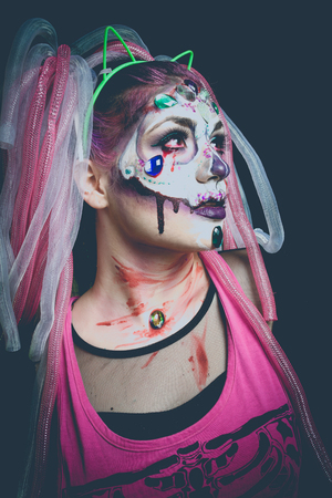 skeleton costume: scary halloween woman with sugar skull makeup portrait studio shot Stock Photo