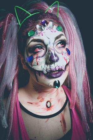 scary halloween woman with sugar skull makeup studio shot Lizenzfreie Bilder