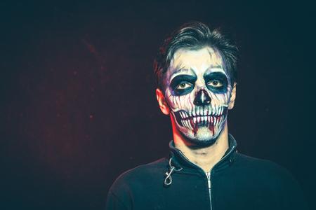 scary halloween skeleton man in jacket studio shot closeup