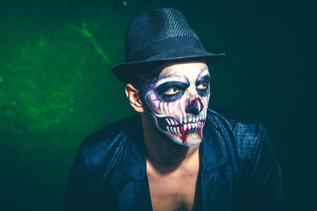 scary halloween skeleton man in jacket and hat  studio shot closeup
