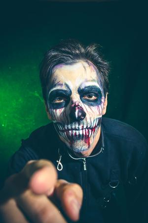 scary halloween skeleton man point with finger studio shot closeup Lizenzfreie Bilder