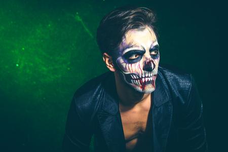 scary halloween skeleton man in jacket studio shot