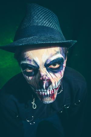 scary halloween skeleton man in jacket and hat studio shot closeup Lizenzfreie Bilder