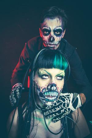 halloween scary cyber skeleton woman and man studio shot