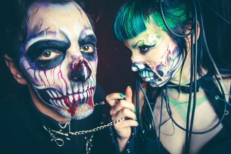 halloween scary cyber skeleton woman and man studio shot closeup