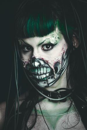 halloween scary cyber skeleton woman studio shot