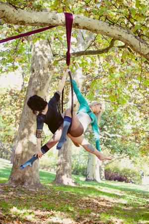two women aerial hoop  dance in forest