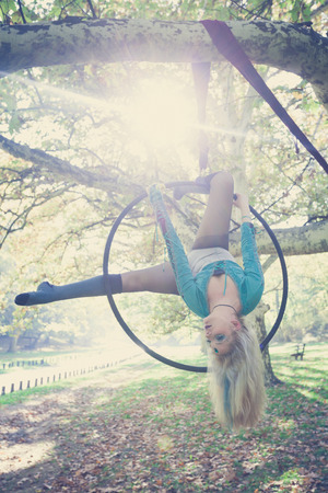 young woman aerial hoop  dance in forest Stock Photo