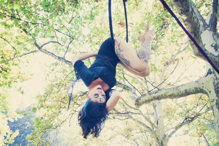 young woman aerial hoop  dance in forest