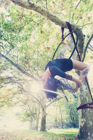 young woman aerial hoop  dance in forest Lizenzfreie Bilder