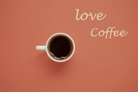 cup of  coffee on pastel background  top view