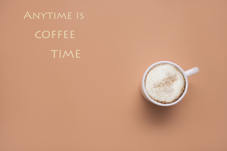morning coffee cup with cappuccino on pastel background  top view  with quote