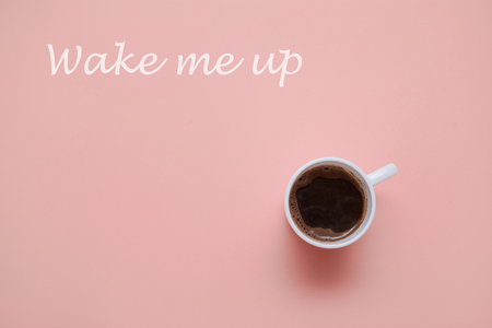 morning coffee cup on pastel pink  background  top view