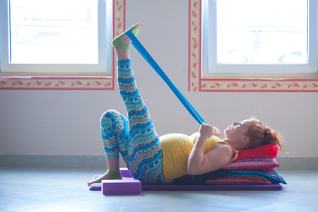 red head pregnant young woman on yoga class indoor  Standard-Bild