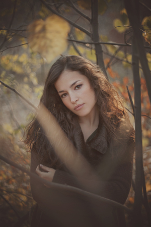 beautiful young woman autumn portrait in forest