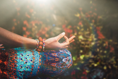 closeup of woman hand in mudra gesture practice yoga meditation outdoor autumn day Stockfoto