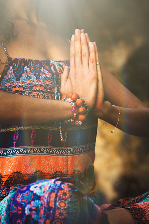 woman hands in namaste gesture practice yoga outdoor day shot