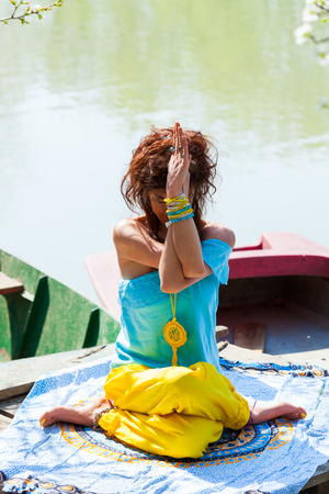 young woman practice yoga outdoor by the lake healthy lifestyle concept  full body shot summer day Stockfoto