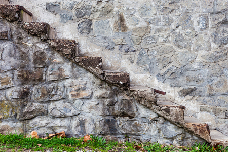 stone stairs on old stone house side view Stockfoto - 122883490