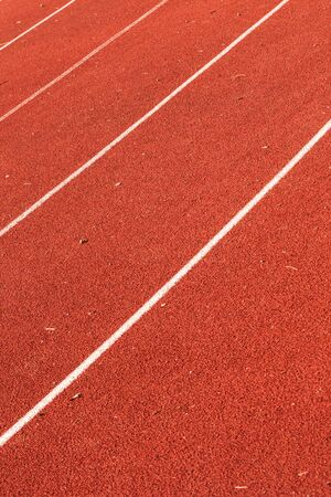 closeup of athletic red running tracks whit white lines