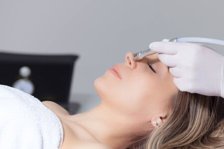 woman face skin treatment in beauty health clinic close