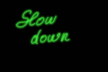 slow down green neon glowing text handwriting