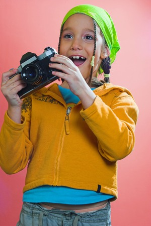 Excited young girl with a camera