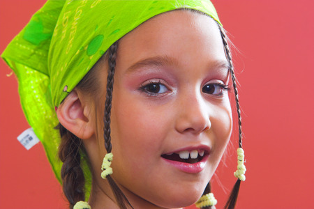 Happy young girl with greeen kerchief