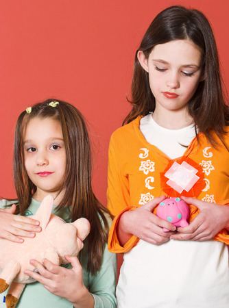 Two girl holding theyre toy banks Stock Photo